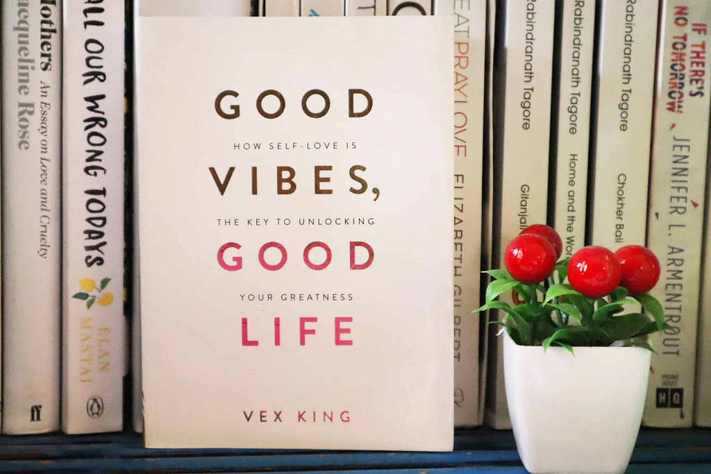 Photo of books. In focus is Good Vibes, Good Life by Vex King. A book is one of the best gifts you can give a friend.